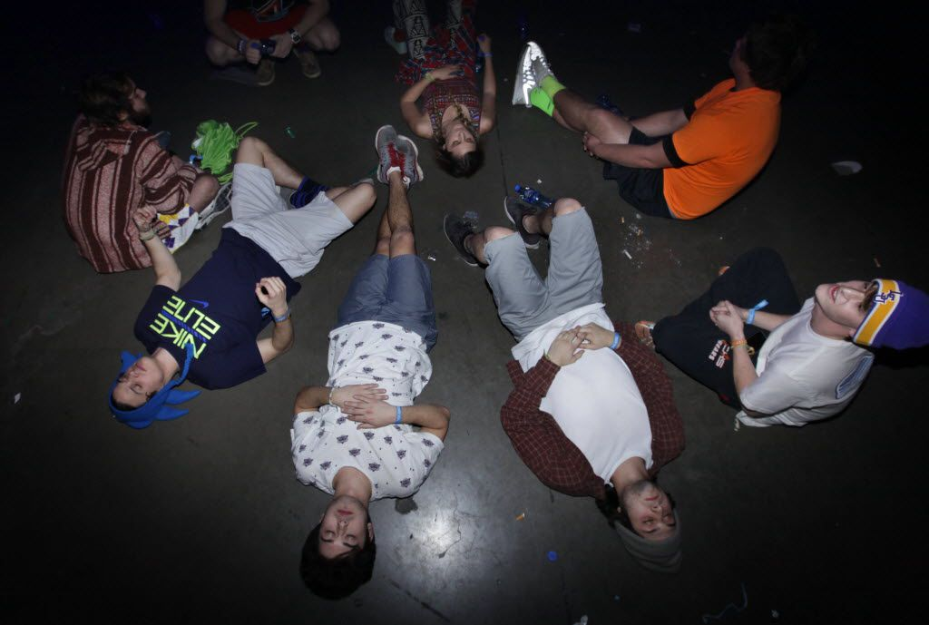 Audience members rest on the floor during the Lights All NIght Festival at the Dallas Convention Center in Dallas, TX, on Dec. 27, 2013. (Jason Janik/Special Contributor)