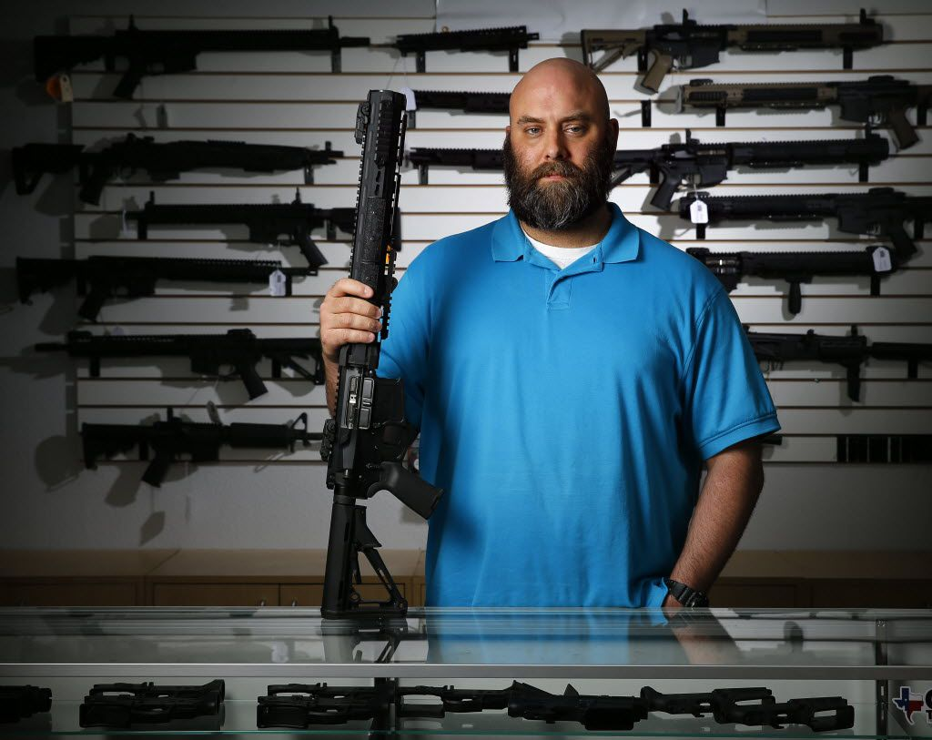 Ro Carter, owner of Mister Guns shop, poses for a photo with a Keystone made Ripsaw AR-15 in Plano, Texas Friday, June 24, 2016. (Tom Fox/The Dallas Morning News)