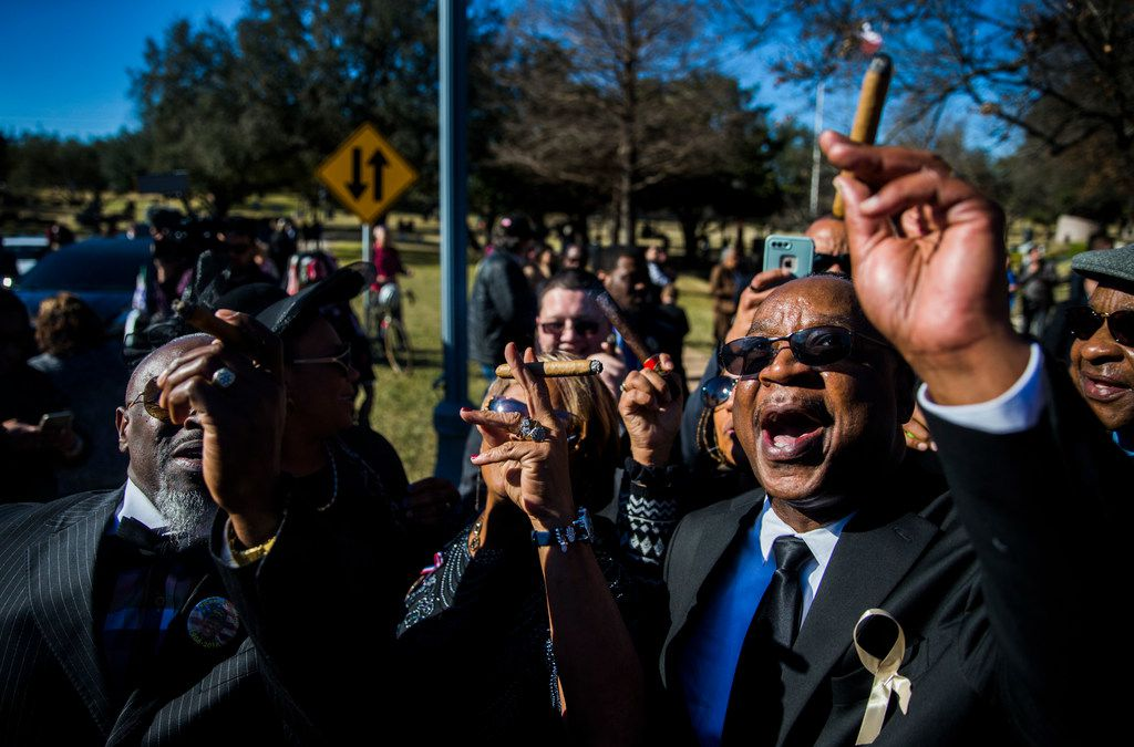 "From left: Brian Gregg, Debra Piper and Martin Wilford smoke cigars and shout, ""We'll miss you, Pops!"" during a graveside service for Richard Overton on Jan. 12, 2019, in Austin."