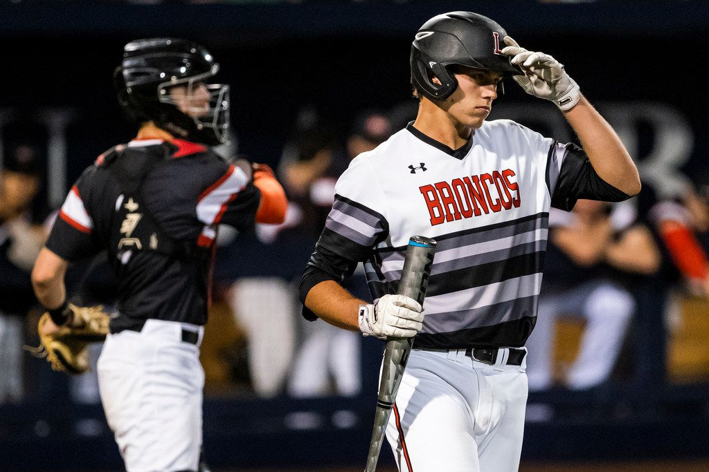 Mansfield Legacy catcher Nate Rombach steps into the batters box during game one of a best-of-three Class 5A Region I quarterfinal baseball playoff series against the Colleyville Heritage at Dallas Baptist University on Thursday, May 16, 2019, in Dallas. (Smiley N. Pool/The Dallas Morning News)