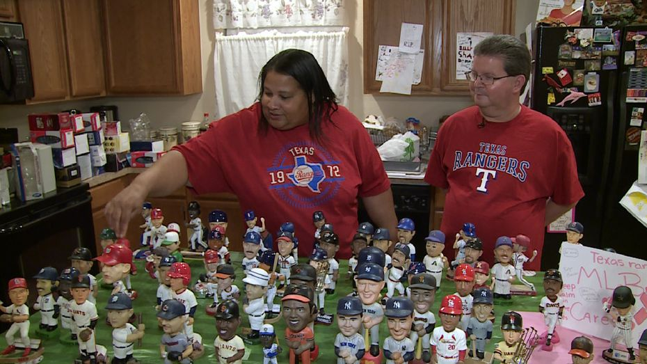 Brenda Jordan Lehew taps the head of a bobblehead among Johnnie Lehew's collection. The Fort Worth resident has been collecting the figurines since 2001. (Tommy Noel/Staff Photographer)