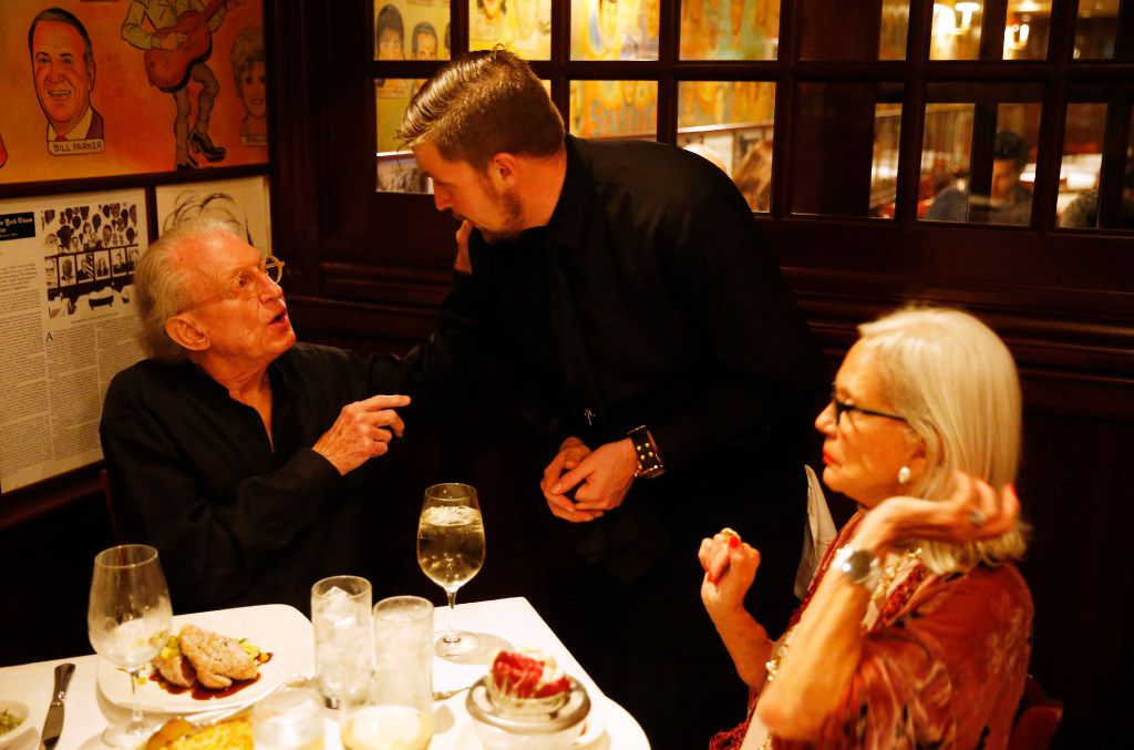 Malcolm Hunter, with his wife, Betty Anne Hunter, talks to A.J. Seppa on the last day of business at the Palm Restaurant in Dallas on Friday, June 30, 2017.
