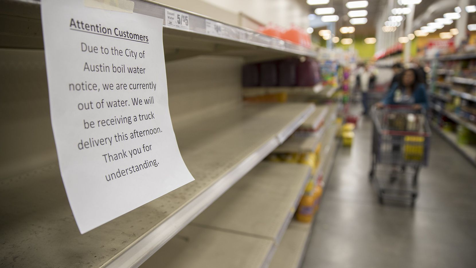 Empty shelves where water was sold at an H-E-B in Austin on Monday.