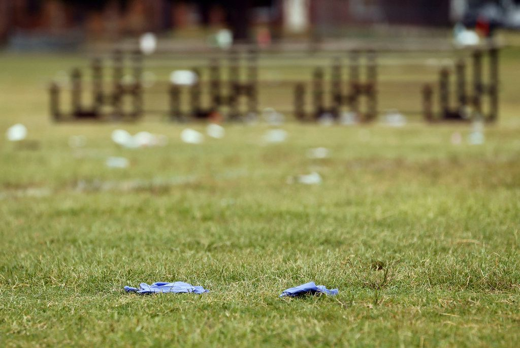 Medical supplies remain on the football field at the Juanita Craft Recreation Center in Dallas on Monday.
