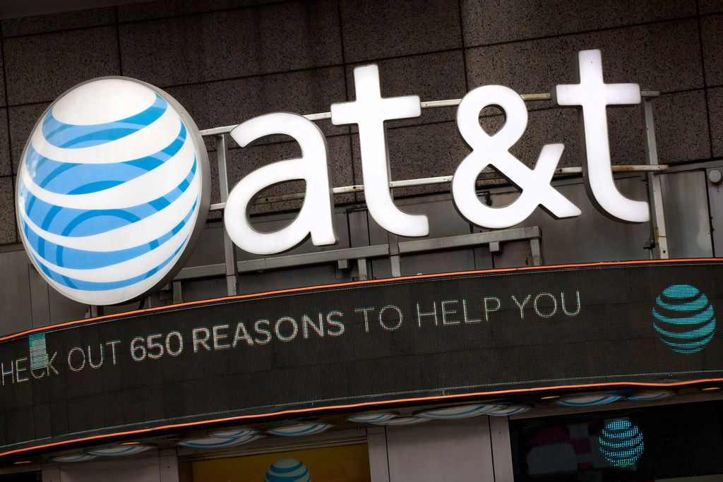 "FILE - In this Oct. 24, 2016, file photo, the AT&T logo is positioned above one of its retail stores in New York. AT&T has drawn ridicule by relabeling the network used by some of its phones as ""5G E"" to signal that the next-generation wireless network is here. Problem is, phones capable of connecting to 5G aren't coming for another few months, and a national 5G network won't be deployed until 2020 or 2021. (AP Photo/Mark Lennihan, File)"