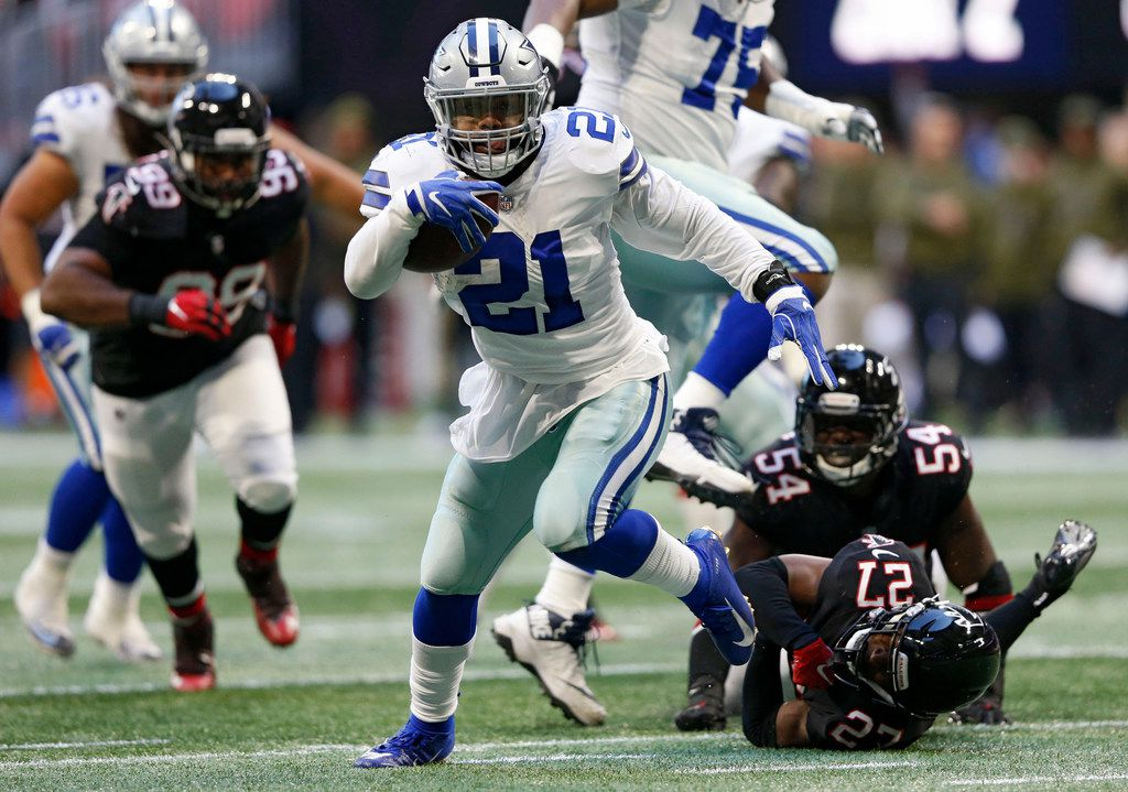 Dallas Cowboys running back Ezekiel Elliott (21) breaks away from defenders Atlanta Falcons linebacker Foye Oluokun (54) and Atlanta Falcons strong safety Damontae Kazee (27) on a 23 yard touchdown run during the second half of play at Mercedes-Benz Stadium in Atlanta on Sunday, November 18, 2018. Dallas Cowboys defeated the Atlanta Falcons 22-19. (Vernon Bryant/The Dallas Morning News) ORG XMIT: DMN1811181638260585