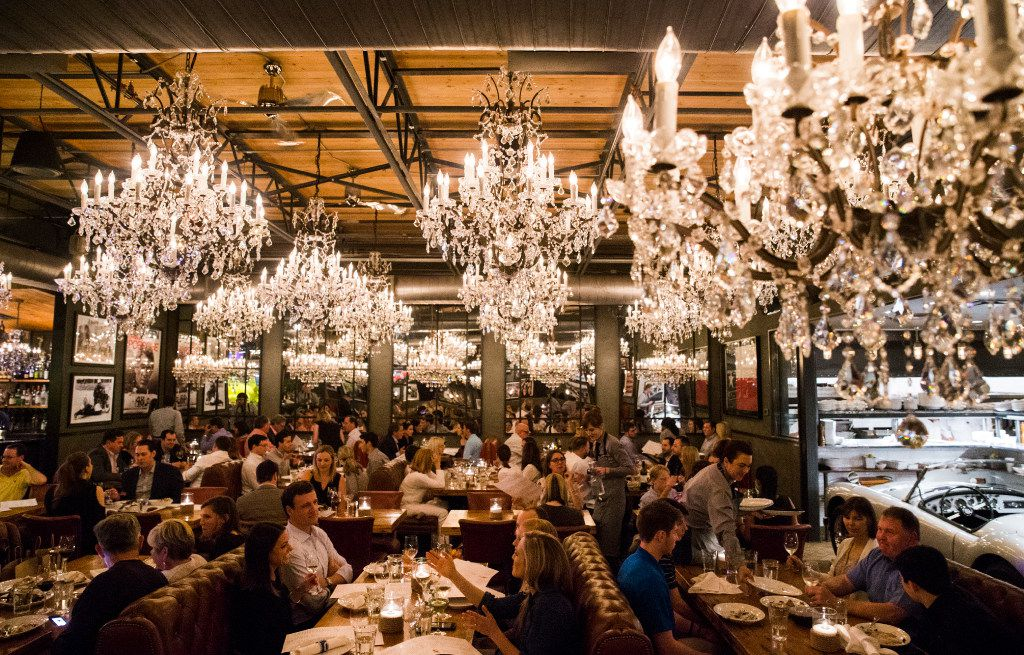 Sixty-four crystal chandeliers decorate the dining room at Town Hearth.  (Ashley Landis/The Dallas Morning News)
