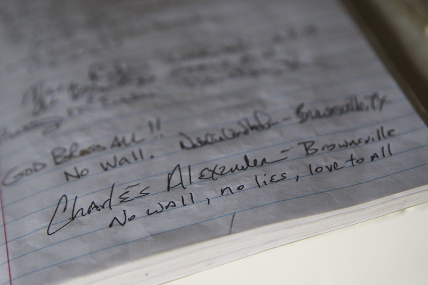 Notes from visitors to La Lomita chapel are seen in a notebook.
