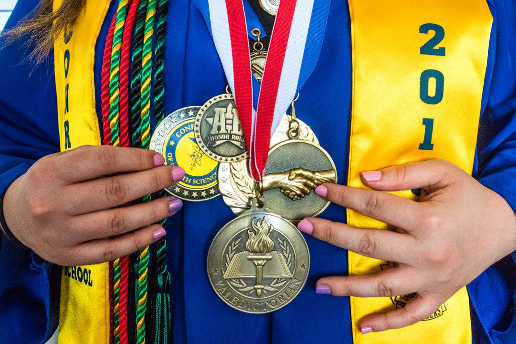 """Former Emmett J. Conrad High School student Albana Gllareva poses for a photograph before graduation at Alfred J. Loos Stadium and Sports Complex in Dallas on June 2, 2018. """"Never give up on your dreams and just be patient,"""" Gallareva said during her graduation speech. (Carly Geraci/The Dallas Morning News)"""