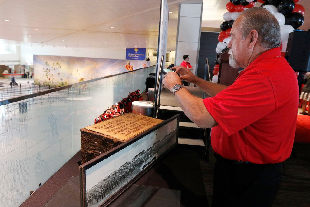 Timothy Smith of Dallas' aviation department takes a photograph of a time capsule on display during the 100th year anniversary celebration of Dallas Love Field on Oct. 19, 2017.