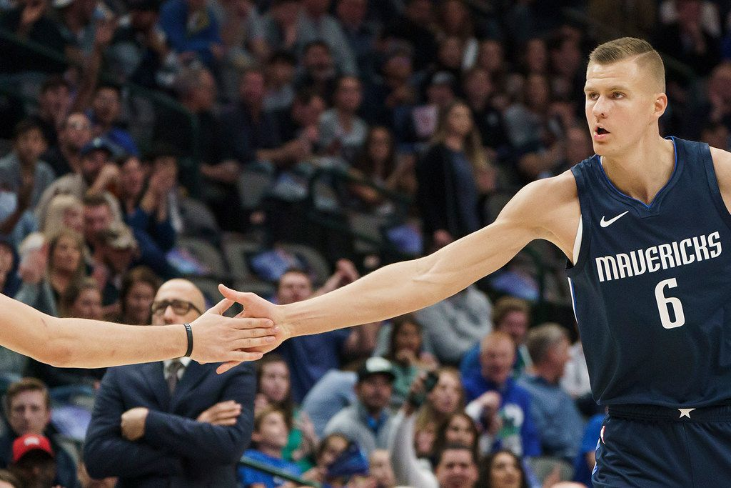 Dallas Mavericks forward Kristaps Porzingis (6) celebrates with guard Luka Doncic during the first half of an NBA basketball game at American Airlines Center on Friday, Nov. 8, 2019, in Dallas. (Smiley N. Pool/The Dallas Morning News)
