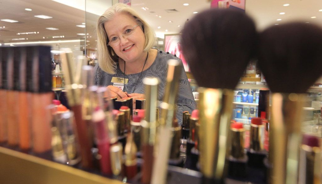 Middle school U.S. history teacher Dawn Cardenas also works at the Estee Lauder counter at Dillard's at Firewheel Town Center. (Louis DeLuca/Staff Photographer)