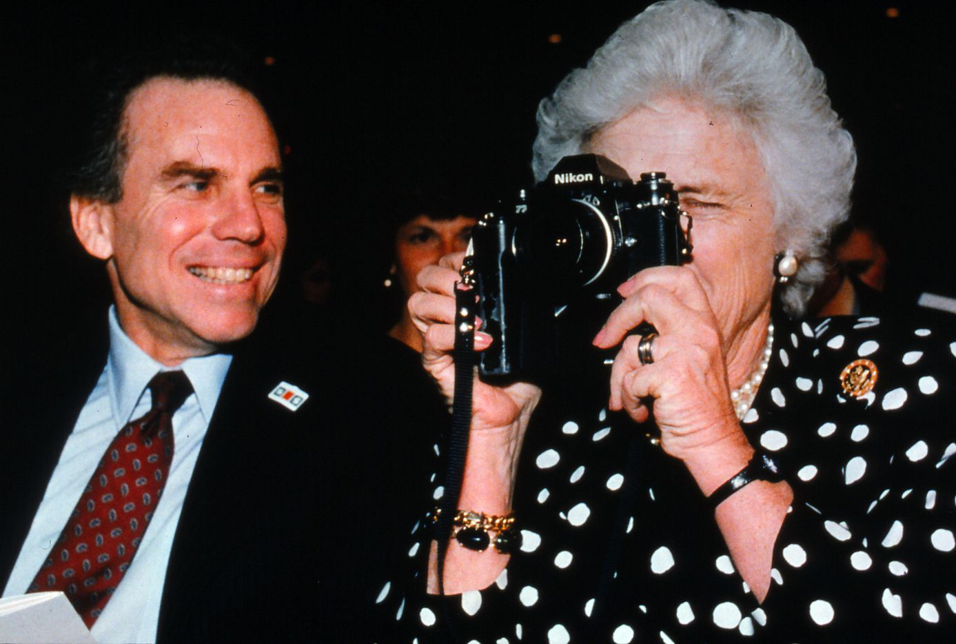 In 1988, Barbara Bush held the camera of a Dallas Morning News photographer, while sitting next to Roger Staubach during a debate at Southern Methodist University.