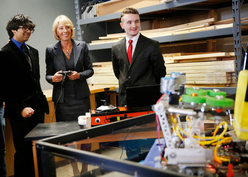 U.S. Secretary of Education Betsy DeVos operates a robot with Haltom High School students Laksha Parajuli (left) and Colton Lyons during a visit to the Birdville Center of Technology and Advanced Learning in North Richland Hills on April 5.