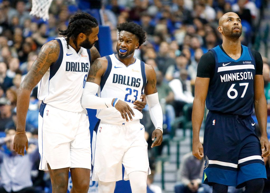 Dallas Mavericks center DeAndre Jordan (6) clams down guard Wesley Matthews (23) who was called for a first half technical foul against the Minnesota Timberwolves at the American Airlines Center in Dallas, Saturday, October 20, 2018. (Tom Fox/The Dallas Morning News)