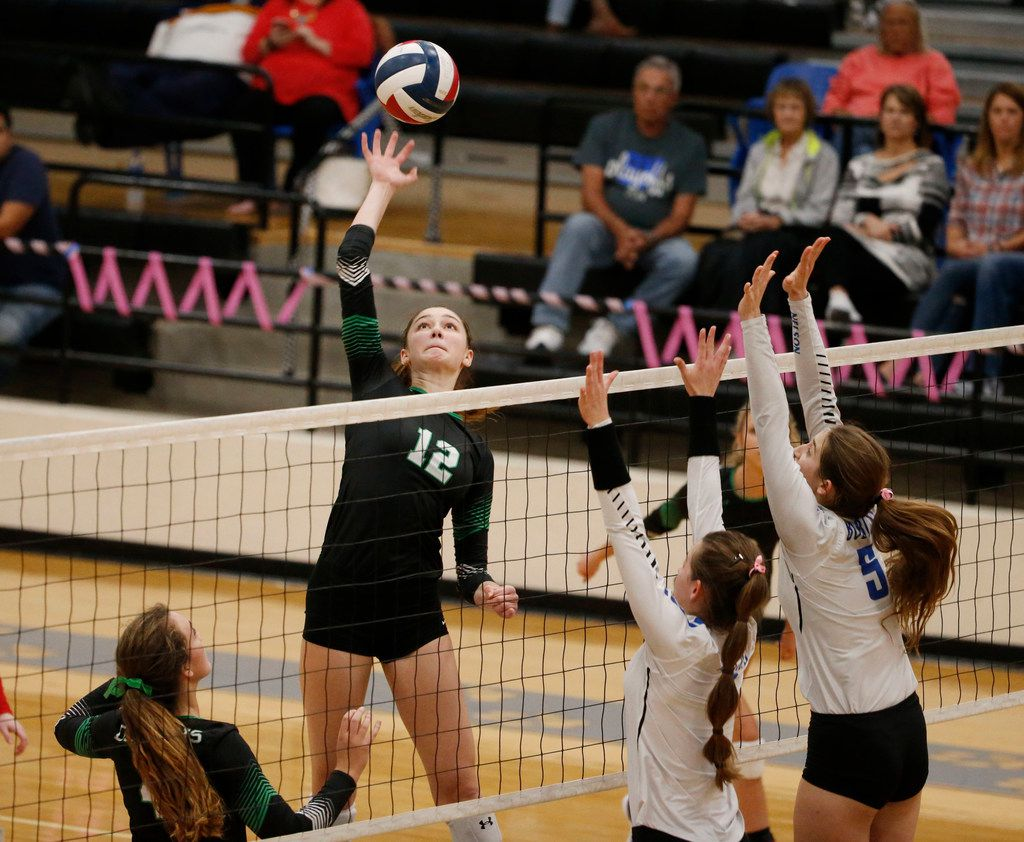 Southlake Carroll's Annabelle Smith (12) hits the ball over Byron Nelson defenders during a match in 2017. (Michael Ainsworth/Special Contributor)