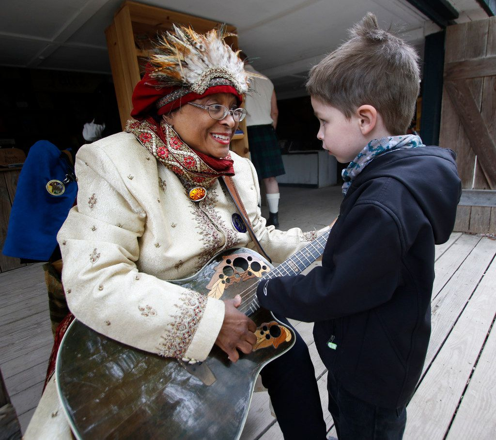 Mason Geeslin, 6, from Euless, receives an impromptu guitar lesson from Dallas musician Leza Mesiah as she took a brief break from playing Irish and Scottish tunes for visitors. The second day of the season-opening weekend of the annual Scarborough Renaissance Festival in Waxahachie was held on April 8, 2018. (Steve Hamm/Special Contributor)
