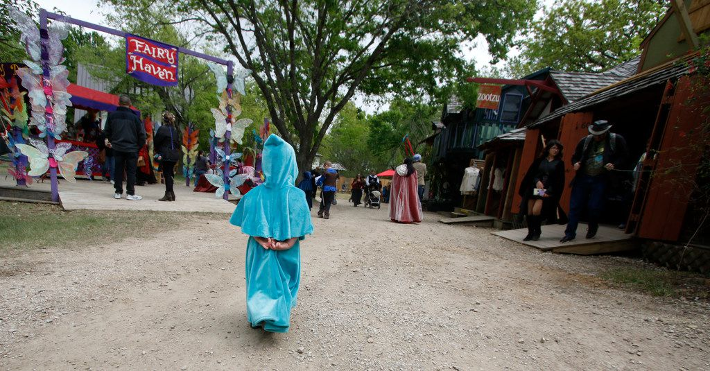 Kate Parent, 2, from Garland, leads a path just in front of her parents as she makes her way through the village. The second day of the season-opening weekend of the annual Scarborough Renaissance Festival in Waxahachie was held on April 8, 2018. (Steve Hamm/Special Contributor)