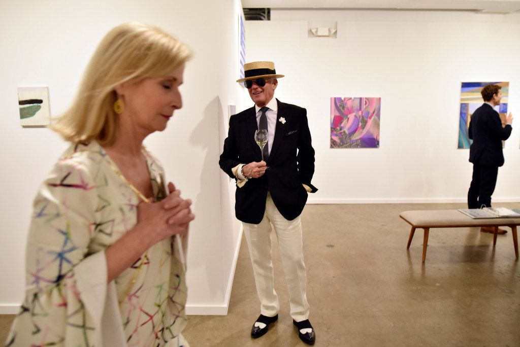 Dallas art collector John Reoch of Dallas browses the galleries while sipping champagne during the Preview Gala of the ninth annual Dallas Art Fair. (Ben Torres/Special Contributor)