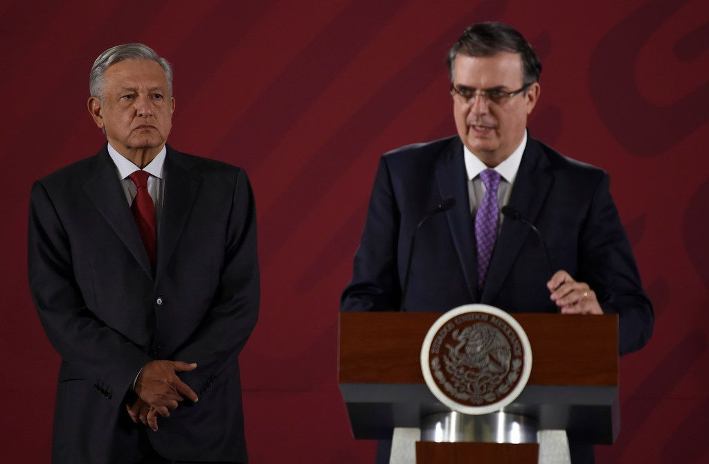 Mexican Foreign Minister Marcelo Ebrard, right, with Mexican President Andres Manuel Lopez Obrador during a news conference at the Palacio Nacional in Mexico City, on June 14, 2019.
