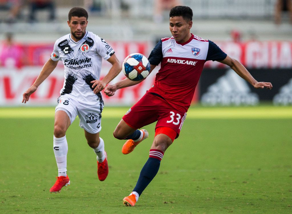 FC Dallas midfielder Edwin Cerrillo (33) takes control of the ball ahead of Club Tijuana midfielder Ignacio Rivero (8) during the first half of a friendly MLS game between FC Dallas and Club Tijuana on Sunday, July 7, 2019 at Toyota Stadium in Friso. (Ashley Landis/The Dallas Morning News)