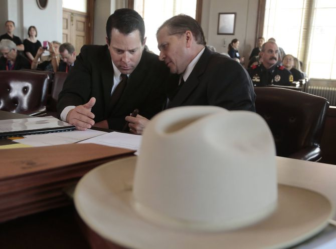 Lee Harvey Oswald, portrayed by Cameron Cox, consults with attorney Toby Shook during a mock trial of Oswald in Dallas on Friday.