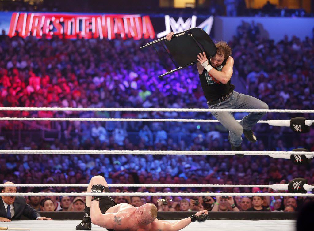 Dean Ambrose, right, wrestles Brock Lesnar during WrestleMania 32 at AT&T Stadium in Arlington, Texas, Sunday, April 3, 2016. (Jae S. Lee/The Dallas Morning News)