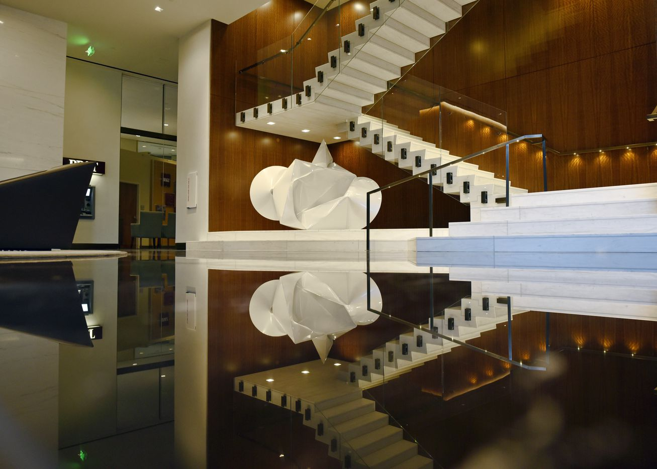 A stair case that leads to the second floor conference center inside the newly updated Trammell Crow Center in downtown Dallas.