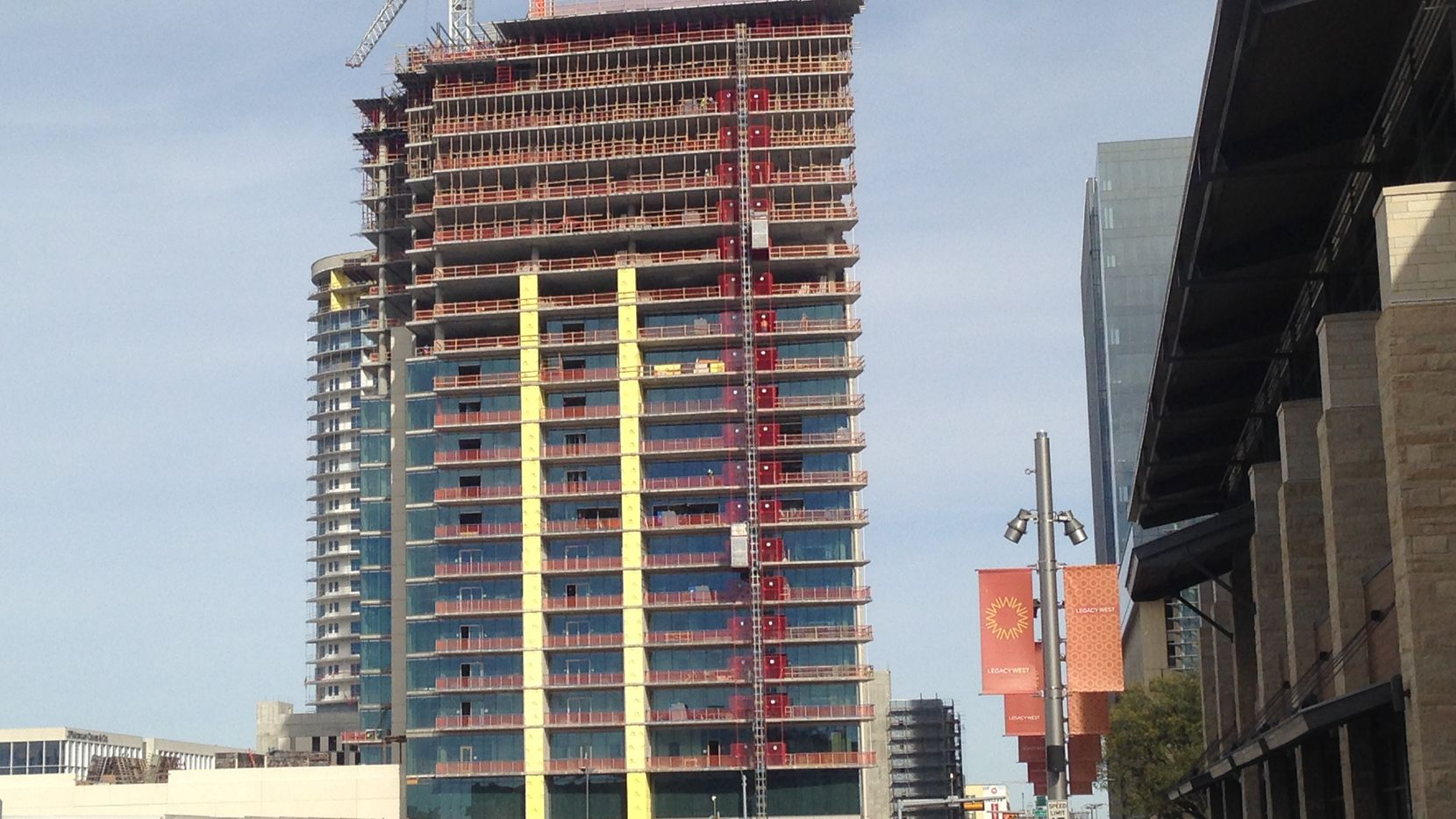 Construction has topped out on the 27-story Windrose Tower in Legacy West.