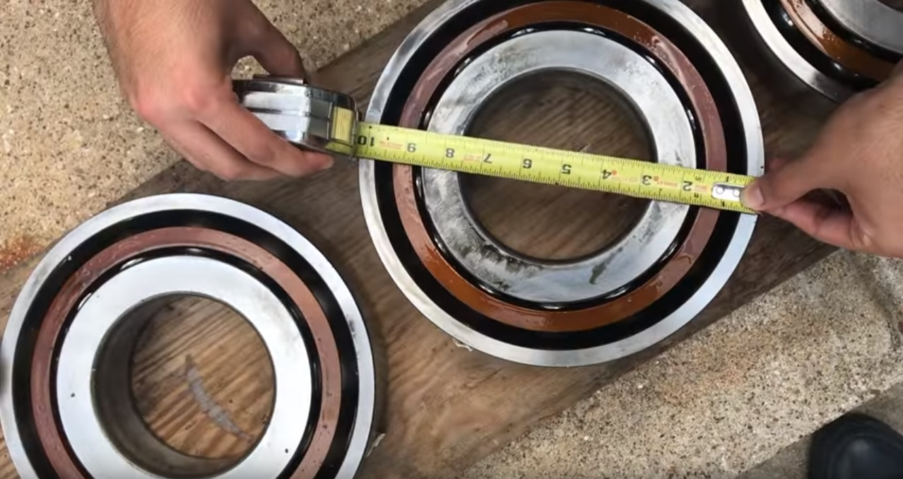 One of the students measures the diameter of a bearing.