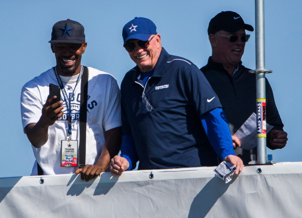 Actor and comedian Jamie Foxx (left) laughs with Dallas Cowboys owner Jerry Jones and Dallas Cowboys Executive Vice President, CEO, and Director of Player Personnel Stephen Jones during an afternoon practice at training camp in Oxnard, California on Monday, July 29, 2019. (Ashley Landis/The Dallas Morning News)