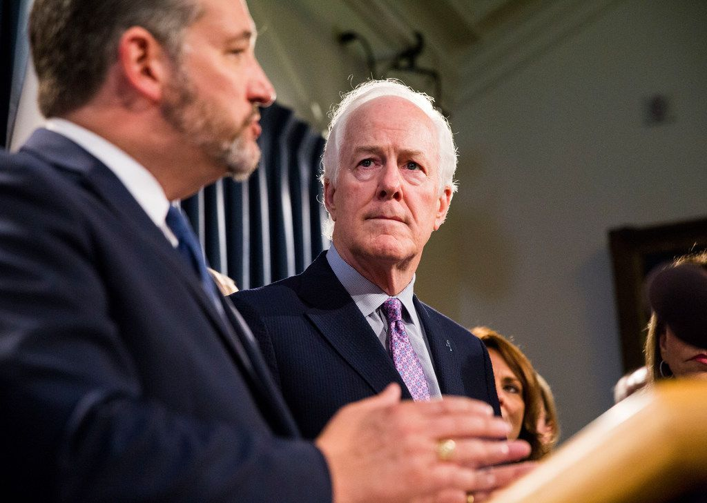 Sen. John Cornyn watches Sen. Ted Cruz during a news conference at the Texas Capitol in Austin on April 17, 2019. Both have distanced themselves from Trump's tariff threat against Mexico.