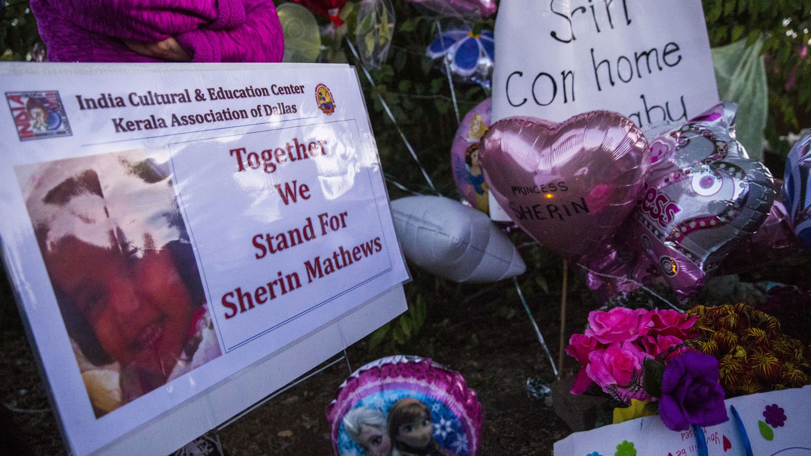 Signs, flowers, balloons and other items collected at a memorial for 3-year-old Sherin Mathews on the day her body was found in late October.