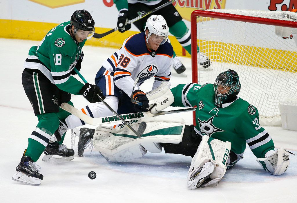 Dallas Stars goaltender Ben Bishop (30) saves a shot by Edmonton Oilers right wing Jesse Puljujarvi (98) as Dallas Stars center Tyler Pitlick (18) gets a rebound during the first period at American Airlines Center in Dallas, Saturday, Jan. 6, 2018. (Jae S. Lee/The Dallas Morning News)