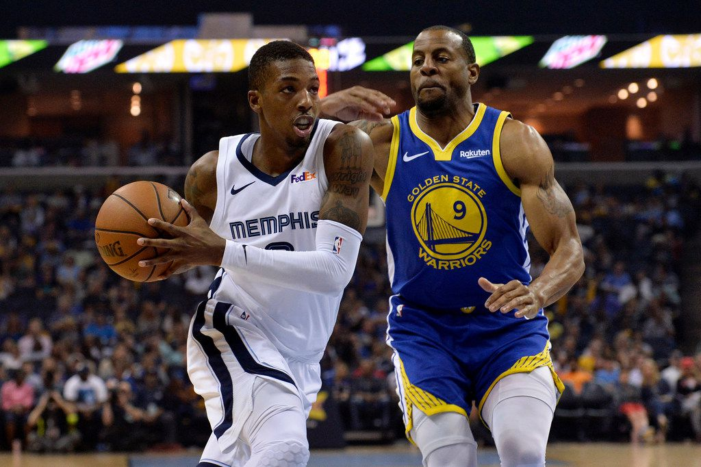 Memphis Grizzlies guard Delon Wright drives against Golden State Warriors guard Andre Iguodala (9) during the first half of an NBA basketball game Wednesday, April 10, 2019, in Memphis, Tenn. (AP Photo/Brandon Dill) ORG XMIT: TNBD106