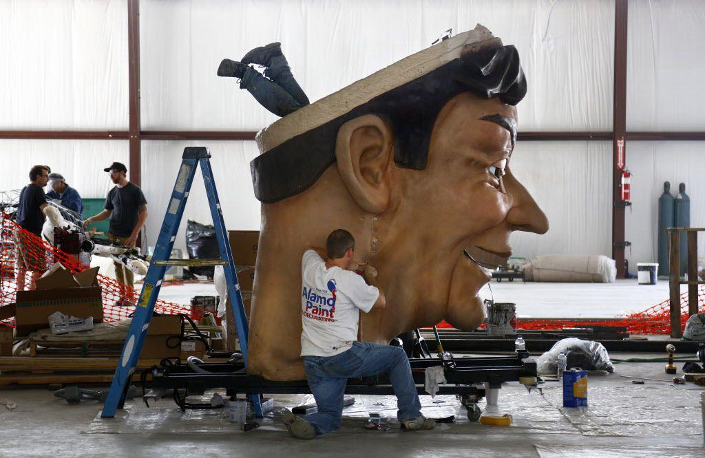New Big Tex takes shape: SRO scenic artist Mike Lindon's feet dangle from Big Tex's head as he and SRO scenic artist Doug Slagle work on September 9, 2013.