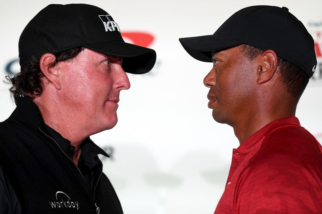 LAS VEGAS, NV - NOVEMBER 20:  (L-R) Phil Mickelson and Tiger Woods face-off during a press conference before The Match at Shadow Creek Golf Course on November 20, 2018 in Las Vegas, Nevada.  (Photo by Harry How/Getty Images for The Match)