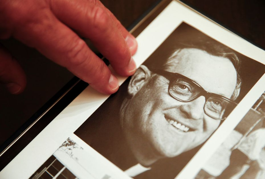 Mike Pedevilla, who also says the Rev. Patrick Koch sexually abused him while he was a student at Jesuit Dallas, points to a picture of Koch in a 1980s yearbook.