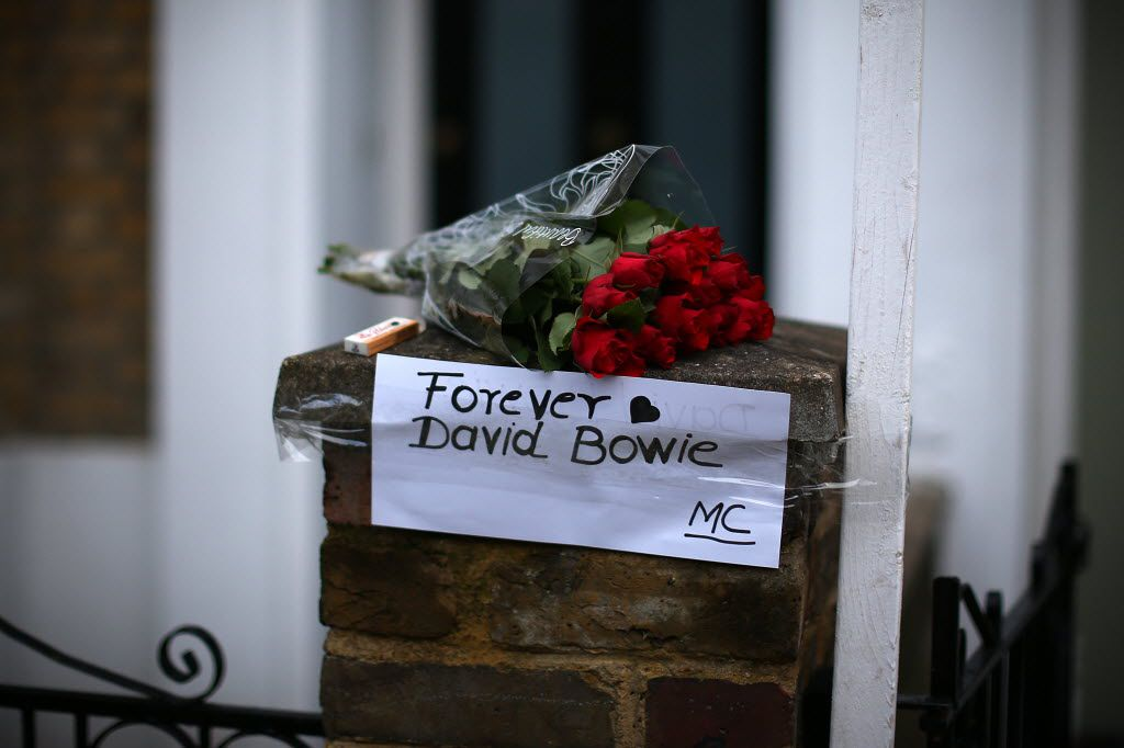 LONDON, ENGLAND - JANUARY 11:  A message is left with flowers outside the boyhood home of David Bowie in Brixton on January 11, 2016 in London, England. British music and fashion icon David Bowie died earlier today at the age of 69 after a battle with cancer.
