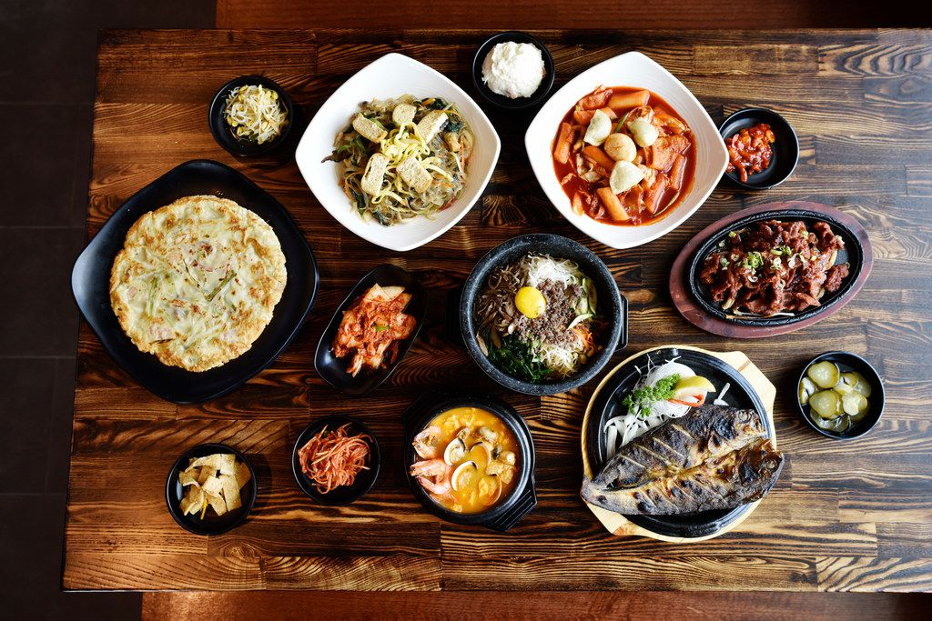 It's typical, say the family members behind BCD Tofu House, to see every table full of plates, big and small.