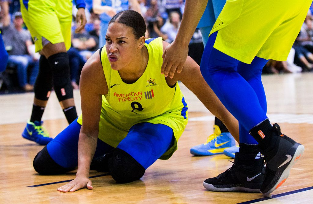 Dallas Wings center Liz Cambage (8) slaps the floor after a foul during the third quarter of a WNBA game between the Dallas Wings and the Chicago Sky on Tuesday, July 31, 2018 at College Park Center on the UTA campus in Arlington. (Ashley Landis/The Dallas Morning News)