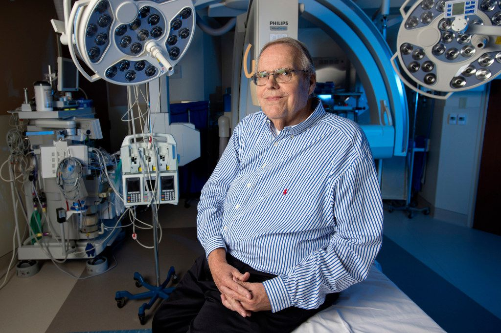 Norbert Schulz, 69, a longtime volunteer at Baylor Jack and Jane Hamilton Vascular Hospital, sits in a cardiac catheterization lab at the Dallas hospital. On Sept. 8, Schulz collapsed from cardiac arrest while he was standing in the hallway near the lab.