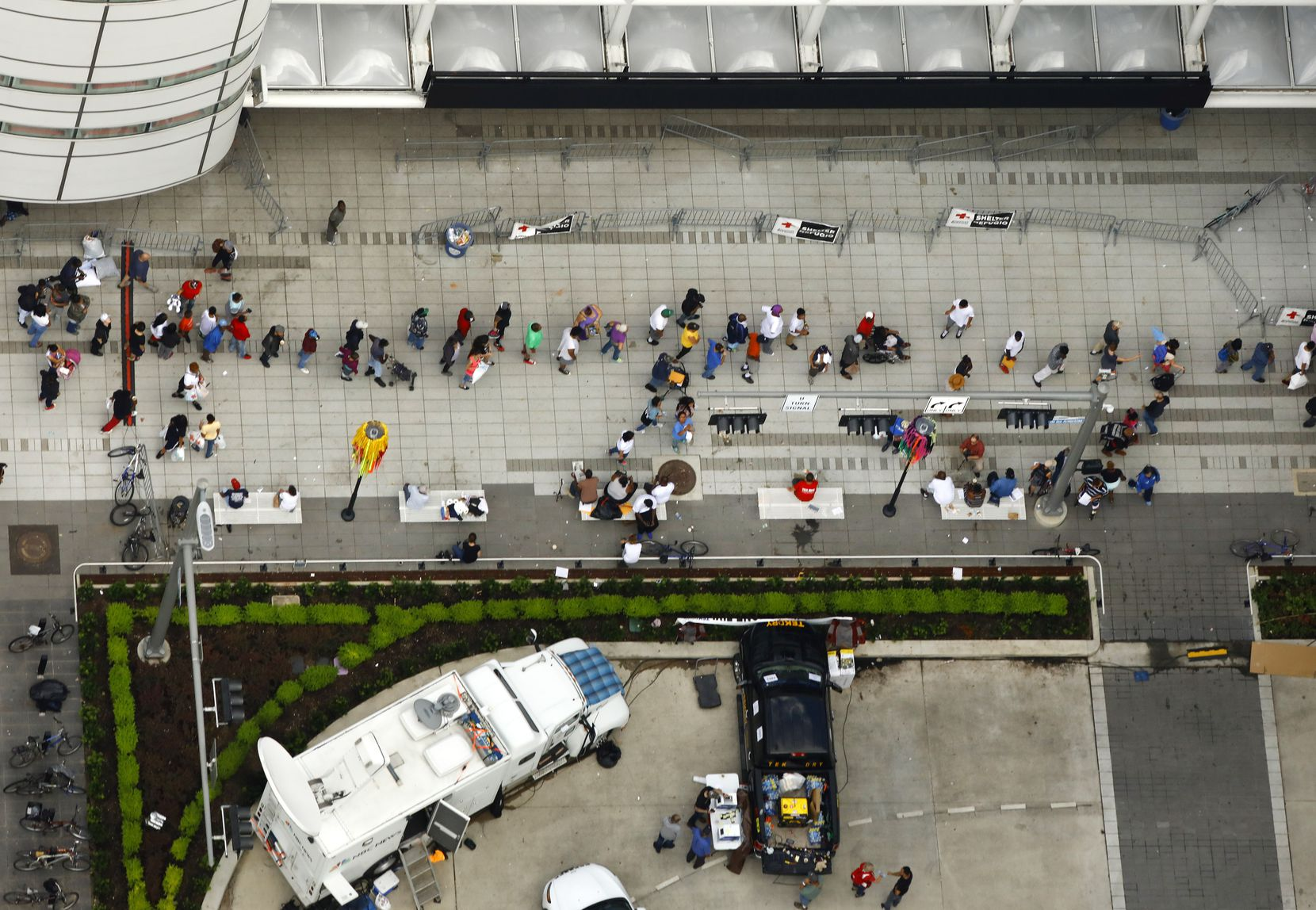 People line up outside the George R. Brown Convention Center, site of the Hurricane Harvey shelter in downtown Houston, Texas, Wednesday, August 30, 2017.