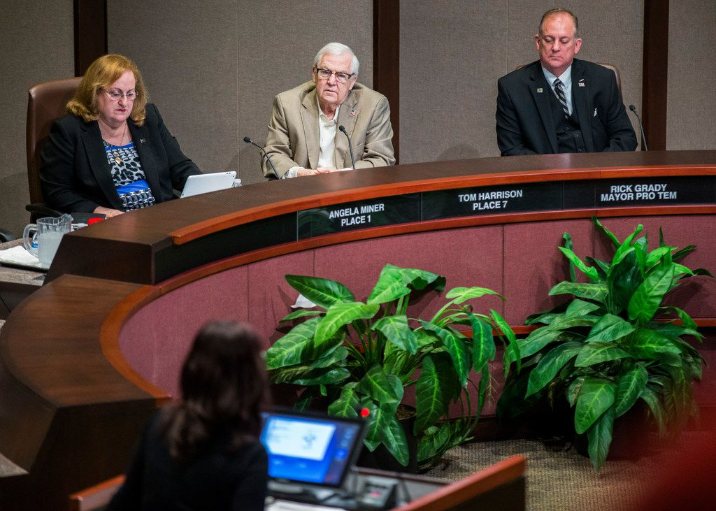 """""""I intend to stay the course,"""" Plano City Council member Tom Harrison (center) said at Monday's council meeting. (Ashley Landis/The Dallas Morning News)"""