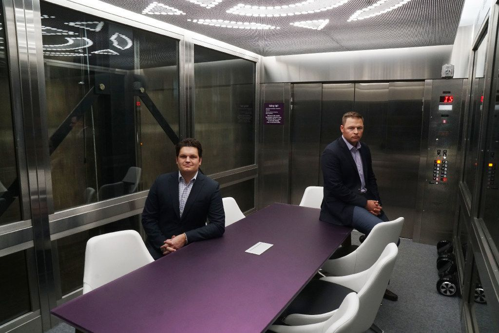 Purple Land Management owners Bryan Cortney and Jesse Hejne in their office in Fort Worth -- in a freight elevator that has been converted into a conference room.