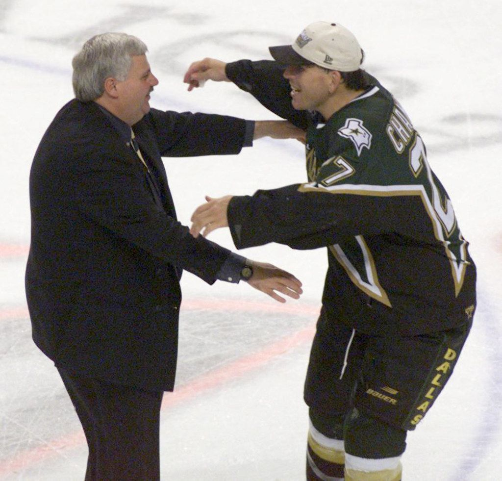 6/19/99 - Stanley Cup Finals, Game 6 - Ken Hitchcock hugs Shawn Chambers after Game 6 of the Stanley Cup Finals at Marine Midland Arena in Buffalo.