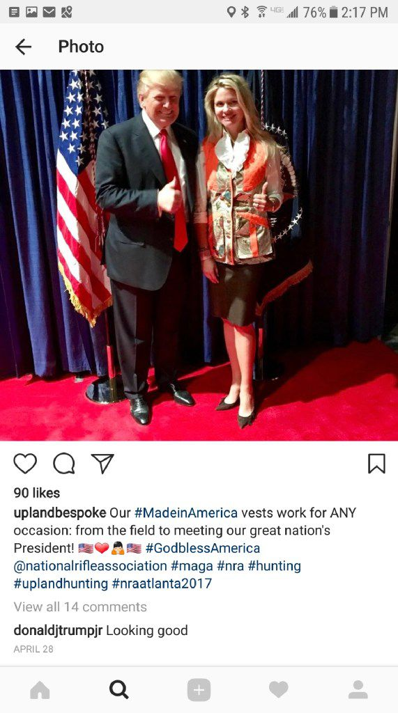 An Instagram post by Kathryn Beach pictures her and President Donald Trump as she wears one of the hunting vests her business sells.