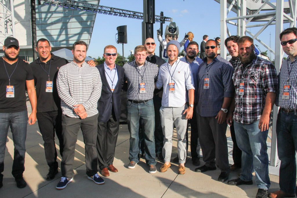 Dallas Cowboys head coach Jason Garrett with some of the Dallas Cowboys players at Taste of the NFL