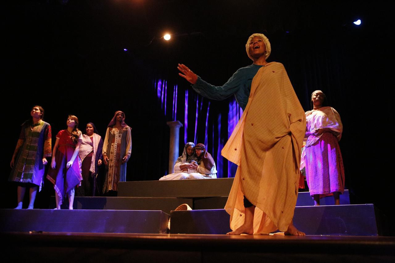 Black Nativity from TeCo Theatrical Productions features a dynamic, versatile ensemble of 23, including Avante Perkins (foreground).