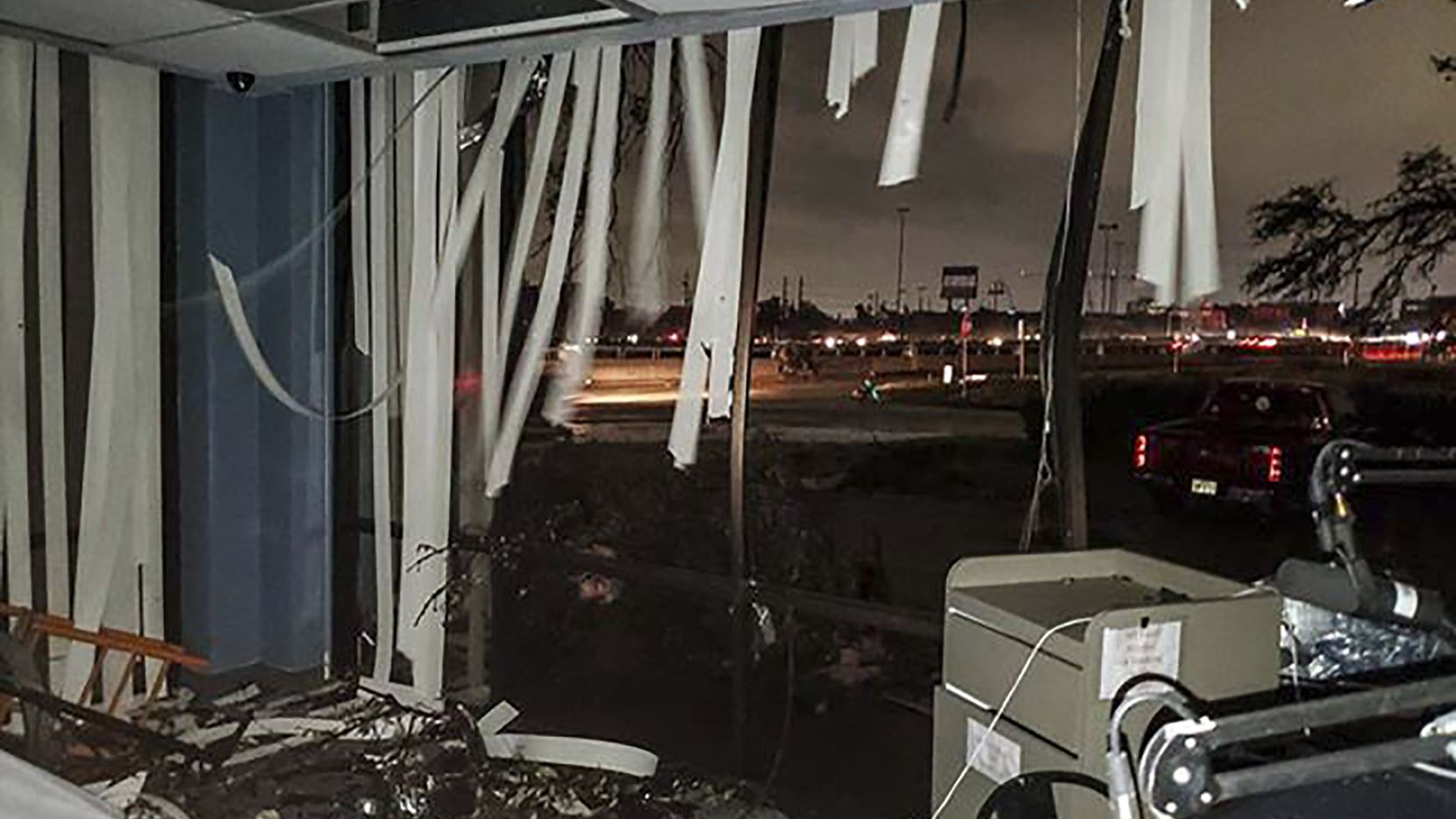 In this Sunday, Oct. 20, 2019 photo offered by Lew Morris, damage to the KNON-FM radio station studio is seen.